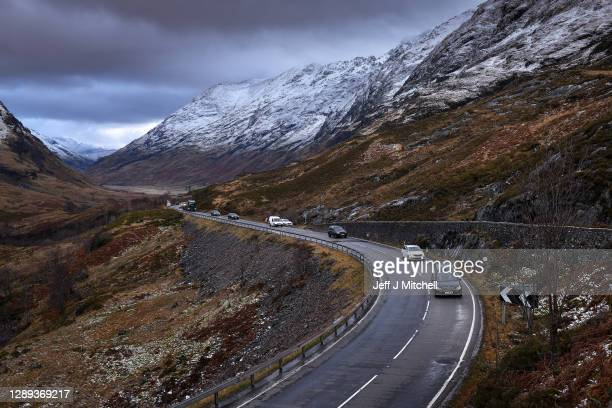 The funeral cortege of Dr Hamish MacInnes OBE BEM, mountaineer, makes its way through Glencoe on December 4, 2020 in Glencoe, Scotland. The climber,...