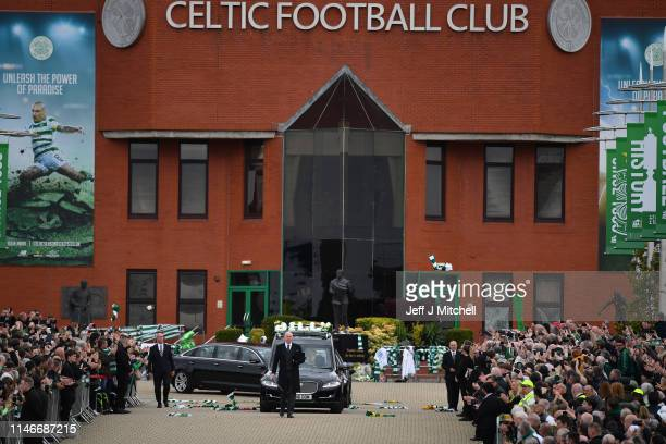 The funeral cortege of former Celtic player and manager Billy McNeill makes its way down Celtic Way past his statue on May 3 2019 in Glasgow Scotland...
