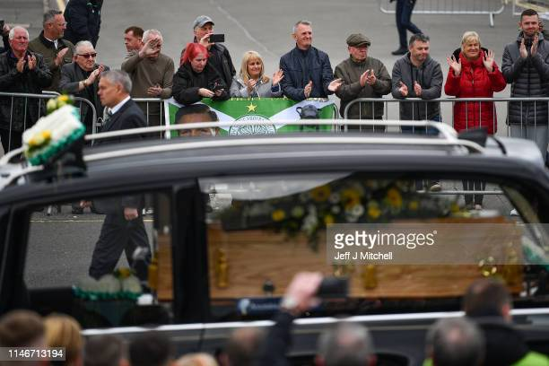 The funeral cortege of former Celtic player and manager Billy McNeill makes it's way down Celtic Way past his statue on May 3 2019 in Glasgow...