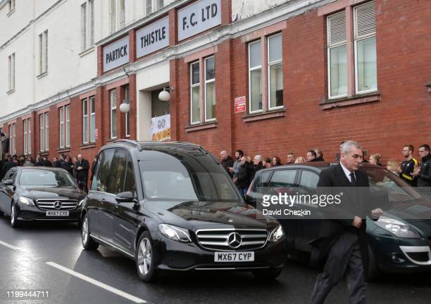 The funeral cortege of lifelong Partick Thistle fan Colin Weir makes its way past Firhill Stadium on January 14 2020 in Glasgow Scotland Lifelong...