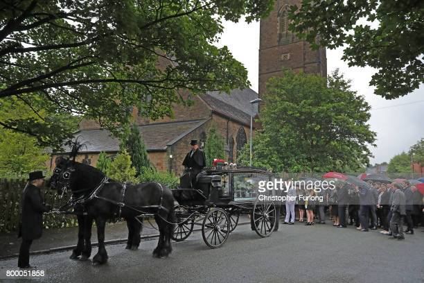 The funeral cortege of Manchester attack victim Alison Howe arrives at St Anne's Church on June 23 2017 in Oldham England Alison Howe from Royton was...
