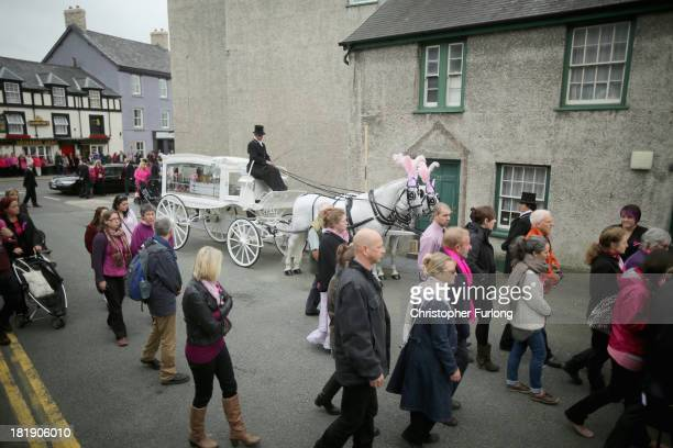 The funeral cortege of murdered schoolgirl April Jones arrives at St Peter's Church for her funeral service on September 26 2013 in Machynlleth Wales...