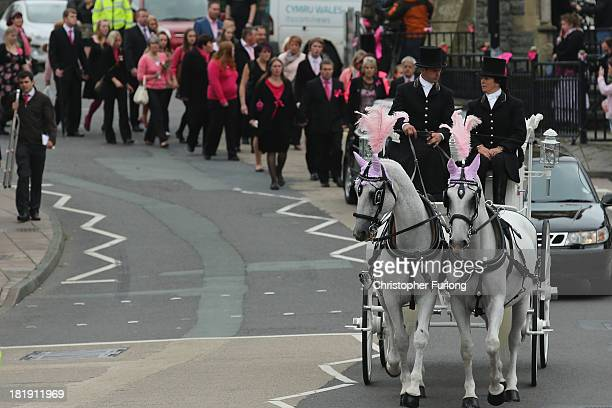 The funeral cortege of murdered schoolgirl April Jones makes it's way through her home town to her funeral service at St Peter's Church on September...