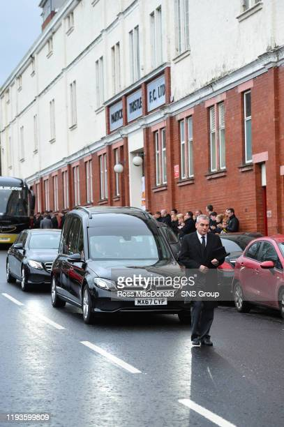 The funeral cortege of Partick Thistles majority shareholder Colin Weir stops at The Energy Check Stadium at Firhill on January 14 in Glasgow Scotland