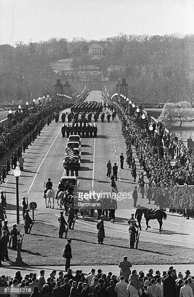 The funeral cortege of President Kennedy turns and crosses onto Memorial Bridge toward Arlington Cemetery The grave site is just below the Curtis Lee...