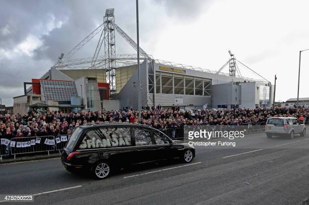 The funeral cortege of Sir Tom Finney passes by Deepdale Stadium the home of Preston North End FC on February 27, 2014 in Preston, United Kingdom....