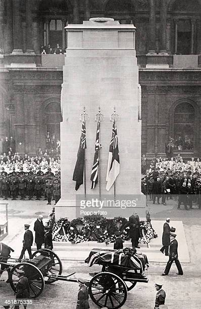 The funeral cortege of the Unknown Warrior of World War One passing the newly unveiled Cenotaph enroute to the burial ceremony in Westminster Abbey...