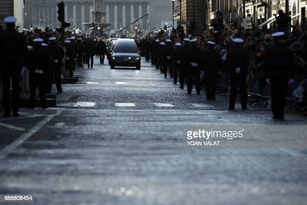 The funeral cortege with the coffin of late French singer Johnny Hallyday arrives at La Madeleine Church prior to the funeral ceremony in Paris on...