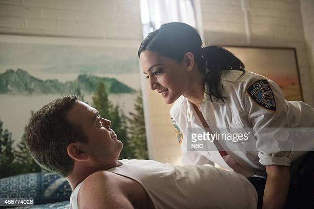 NINE 'The Funeral' Episode 302 Pictured Joe Lo Truglio as Charles Boyle Archie Panjabi as Lieutenant Thakurta