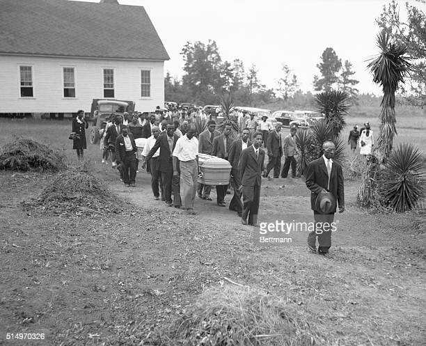 The funeral for two of the victims in the July 25th lynching in Walton County were held at the Mt Perry Baptist Church Sunday This photo shows the...