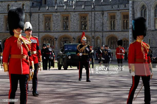 The funeral jeep carrying the coffin is driven during the ceremonial funeral procession of Britain's Prince Philip, Duke of Edinburgh to St George's...
