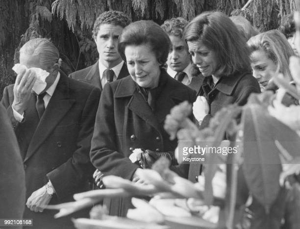The funeral of Athina 'Tina' Onassis Niarchos wife of Stavros Niarchos in Lausanne Switzerland October 1974 From left to right Stavros Niarchos and...