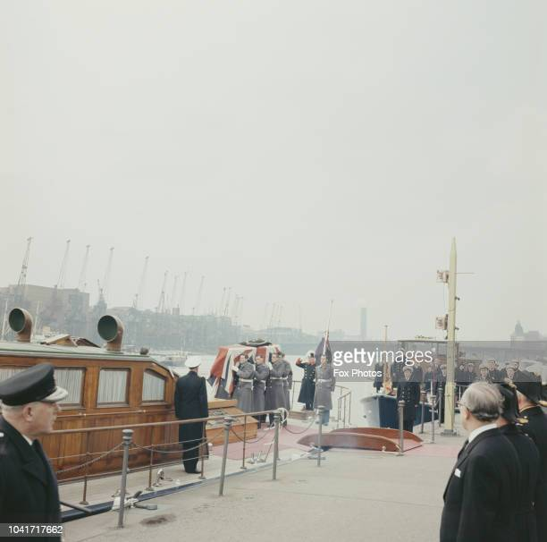 The funeral of former Prime Minister Winston Churchill in St Paul's Cathedral London 30th January 1965 Churchill's coffin is carried onto the 'MV...