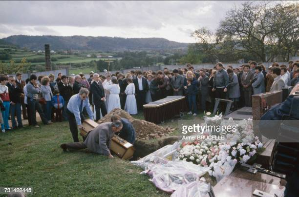 The funeral of murdered four yearold boy Grégory Villemin takes place in Lepanges Sur Vologne Vosges France 19th October 1984 At centre are Grégory's...
