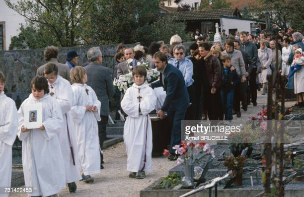 The funeral of murdered four yearold boy Grégory Villemin takes place in Lepanges Sur Vologne Vosges France 19th October 1984 Behind the coffin are...