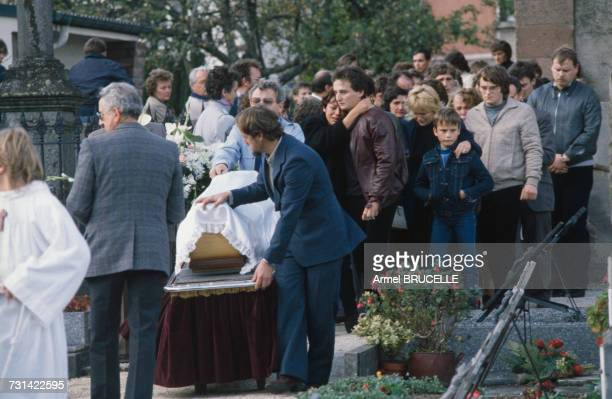 The funeral of murdered four year-old boy Grégory Villemin takes place in Lepanges Sur Vologne, Vosges, France, 19th October 1984. Behind the coffin...