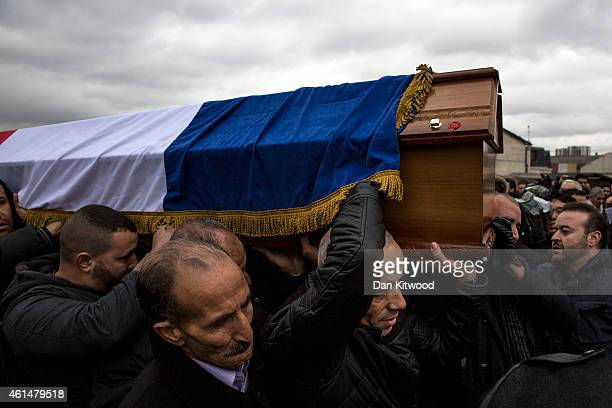 The funeral of murdered police officer Ahmed Merabet takes place at a muslim cemetery on January 13 2015 in Bobigny France All three police officers...