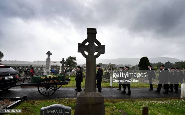 The funeral of veteran Irish republican Billy McKee is given a guard of honour by D Company members former IRA members and prisoners as it makes it's...