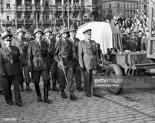 The funeral precession of the late Czech President Edvard Benes is carried through the streets on a military guncarriage in Prague Czechoslovakia 1948