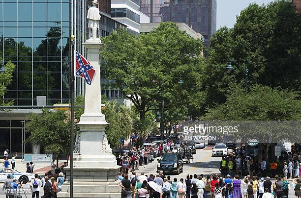 The funeral procession for Emanuel AME Church pastor and South Carolina State Sen Clementa Pinckney travels down Main Street to the South Carolina...