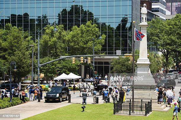 The funeral procession for Emanuel AME Church pastor and South Carolina State Sen Clementa Pinckney arrives at the Statehouse on June 24 2015 in...