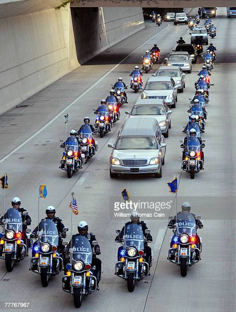 The funeral procession for Philadelphia Police Officer Chuck Cassidy is excorted by police motorcycles as it makes its way to the cemetary November 7...