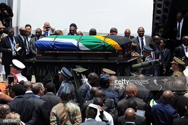 The funeral procession leaving for the grave site following Madiba's State Funeral on December 15 2013 in Qunu South Africa Nelson Mandela passed...