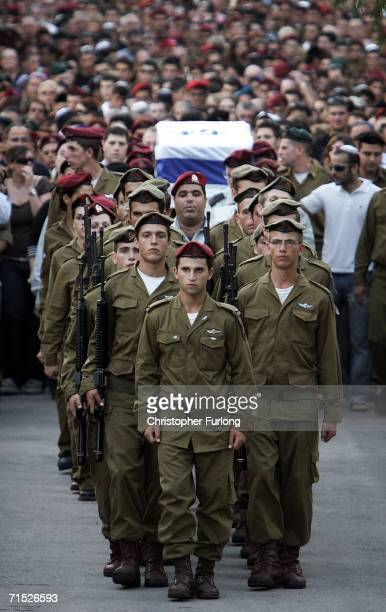 The funeral procession of Israeli paratrooper Yiftach Shrayer makes it's way to his burial flanked by hundreds of mourners and fellow soldiers in...