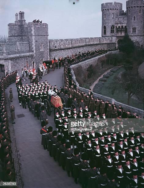 The funeral procession of King George VI arrives at Windsor Castle, Berkshire.