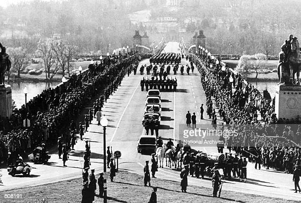 The funeral procession of President John F Kennedy goes into Arlington Cemetary in Washington On November 22 Kennedy was killed by an assassin's...