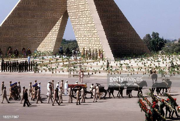 The funeral procession of Sadat President walking kick over the mausoleum of the unknown soldier present on the background the grave is wrap on the...