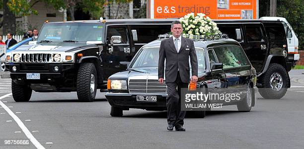 The funeral procession of slain gangland killer Carl Williams leaves the funeral service, in Melbourne on April 30, 2010. Carl Williams was bashed to...