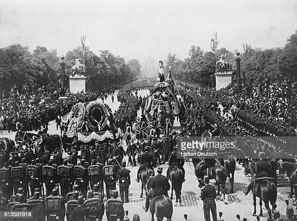 The funeral procession of Victor Hugo the French poet and writer watched by large crowds in Paris 1885