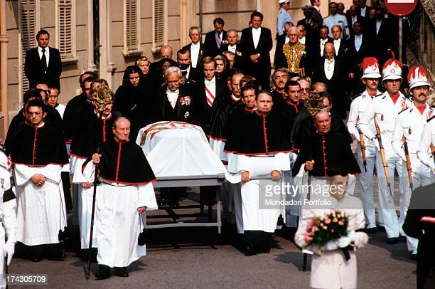 The funeral procession with Carabinieri of Monaco on picket duty in front of the Cathedral of Monaco during the funeral of Princess Grace next to the...