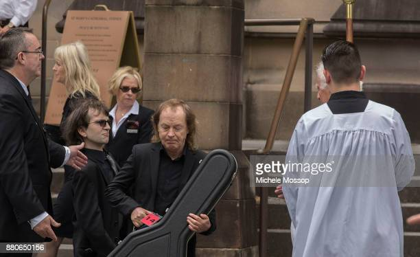 The funeral service for AC/DC cofounder Malcolm Young at St Mary's Cathedral Ross young son of Malcolm and uncle Angus Young follow Malcolm's coffin...