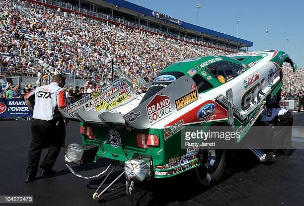 The Funny Car of Ashley Force Hood waits for her run during the O'Reilly Auto Parts NHRA Nationals at zMax Dragway on September 19 2010 in Concord...