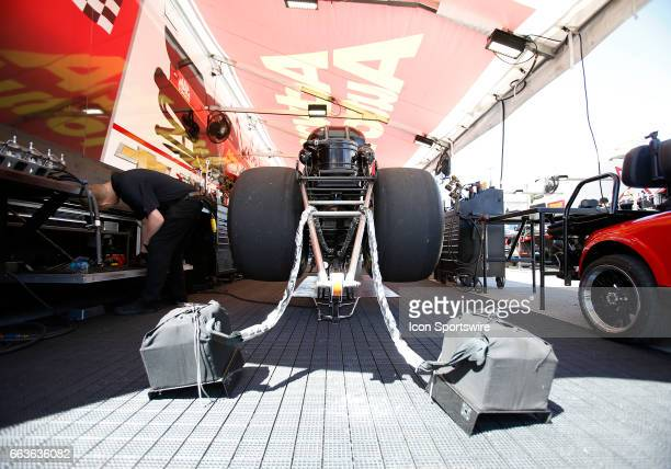 The funny car of Courtney Force John Force Racing Chevrolet Camaro SS NHRA Funny Car sits on jack stands as it is prepared for racing during the NHRA...