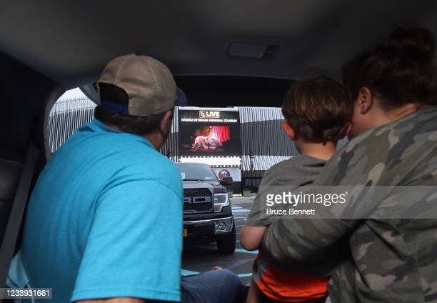 The Furman family of East Northport watch the movie 'Trolls' at a drive-in movie arranged by Nassau County at the parking lot of NYCB's LIVE at the...