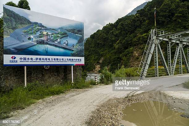 The future appearance of the chinese Upper Marsyangdi hydroelectric powerplant project is displayed on a big signboard