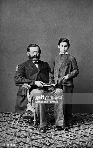The future founder of psychoanalysis Sigmund Freud posing next to his father Jacob Freud Austria 1864