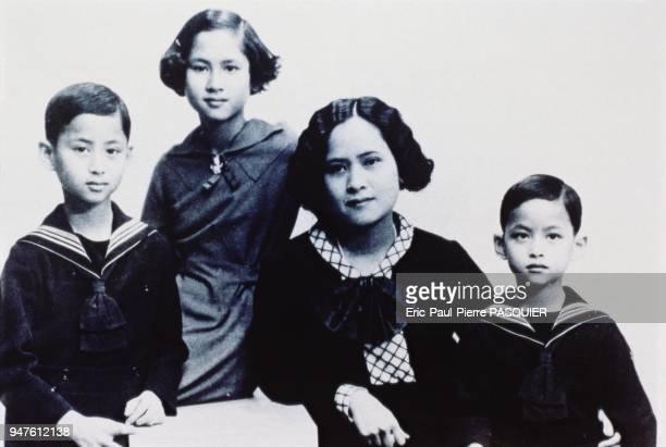 The future King Bhumibol poses with his mother Princess Sangwalya his sister Galyani Vadhana and his brother Anadha Mahidol
