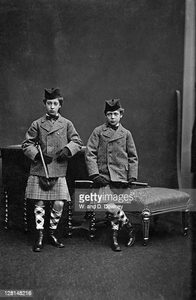 The future King George V with his older brother the Duke of Clarence , dressed for a Scottish hunting expedition, circa 1873. They are wearing kilts,...