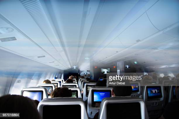 the future of commercial airlines, transparent fuselage airplanes. - claustrophobia stock photos and pictures