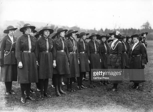 The future Queen Consort to King George VI, Lady Elizabeth Bowes-Lyon , inspecting Girl Guides at Glamis in Scotland near her family home, Glamis...