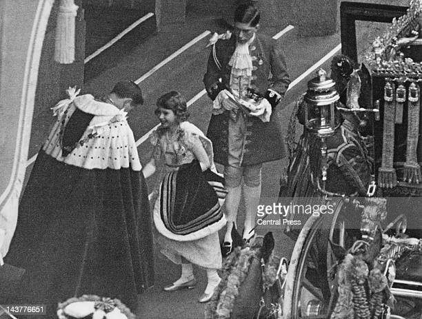 The future Queen Elizabeth II arrives at Westminster Abbey for the coronation of her father King George VI 12th May 1937 She is greeted by the Earl...