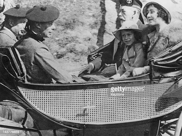 The future Queen Elizabeth II in a carriage with King George V and her parents, the Duke and Duchess of York , circa 1933.