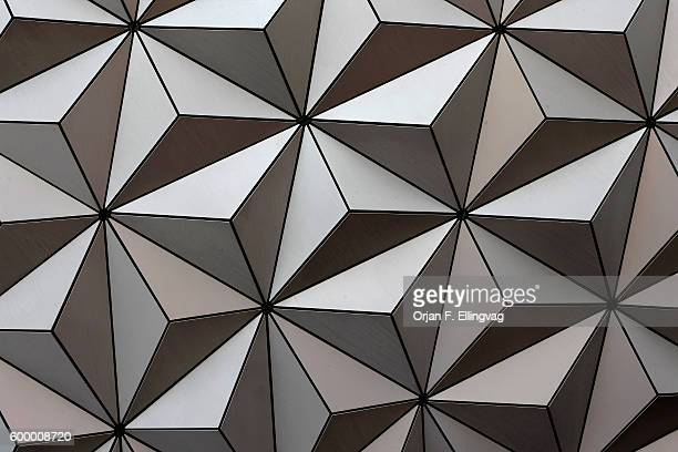 The futuristic prism design of the globe at the center of the EPCOT Center part of Disney World in Orlando