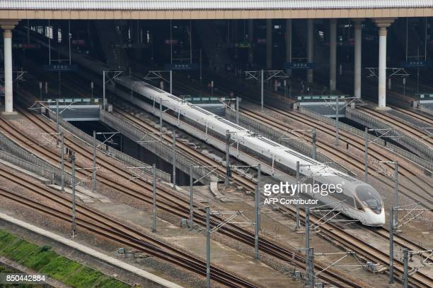 The 'Fuxing' bullet train leaves Nanjing south railway station in Nanjing in China's eastern Jiangsu province on September 21 2017 China increased...