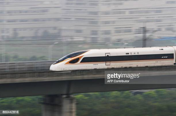 The Fuxing bullet train rans on the BeijingShanghai Railway in Changzhou in China's eastern Jiangsu province on September 21 2017 China increased the...