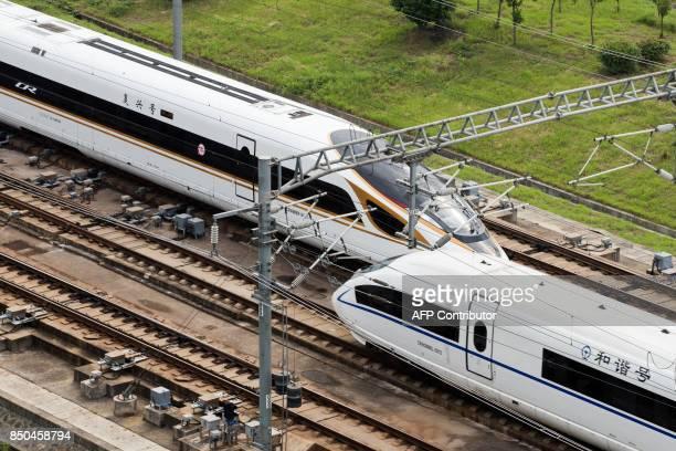 The Fuxing bullet train runs on the BeijingShanghai Railway in Nanjing in China's eastern Jiangsu province on September 21 2017 China increased the...